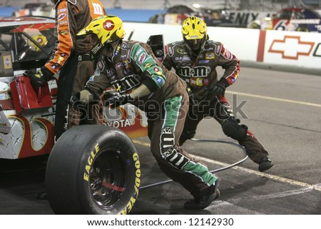 13 seconds to change 4 Tires - stock photo