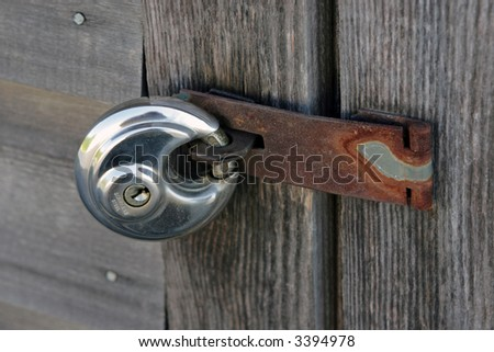 """Security"" Steel lock on wooden door. - stock photo"