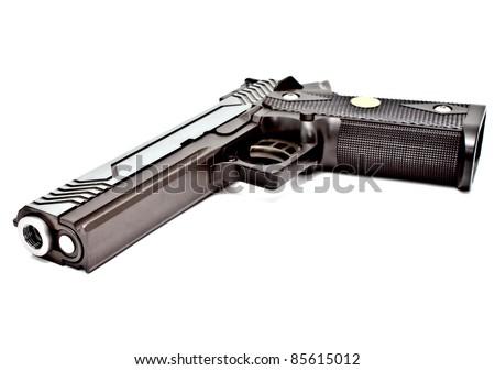 .45 semi-automatic handgun  laying on white floor, studio shot - stock photo