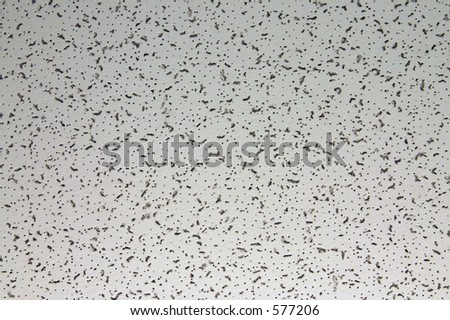 Semi-closeup of a common cellulose ceiling tile. Interesting texture that can be used as background. Very crisp. - stock photo