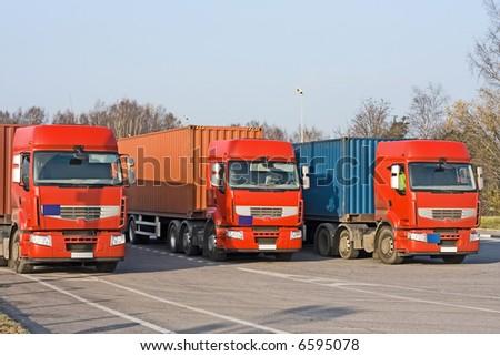 "3 Semi trucks at warehouse loading dock of my portfolio ""trucks"" series - stock photo"