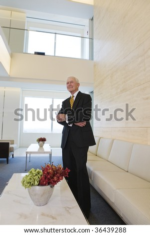 Senior businessman waiting for a meeting.