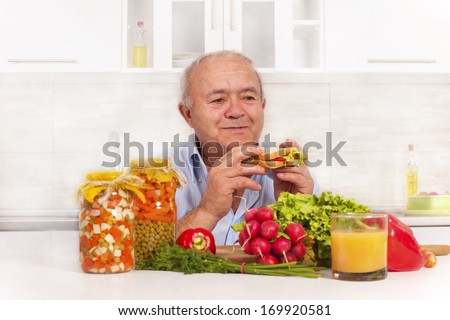 senior man eating healthy diet - stock photo