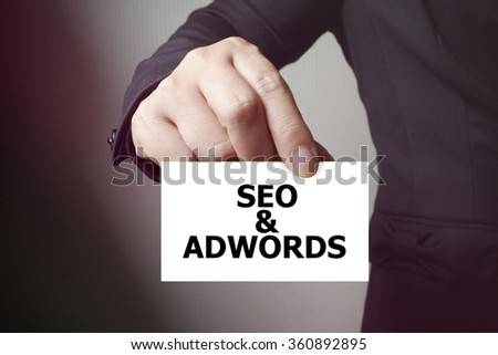 SEO & ADWORDS paper on the card , business concept , business idea - stock photo