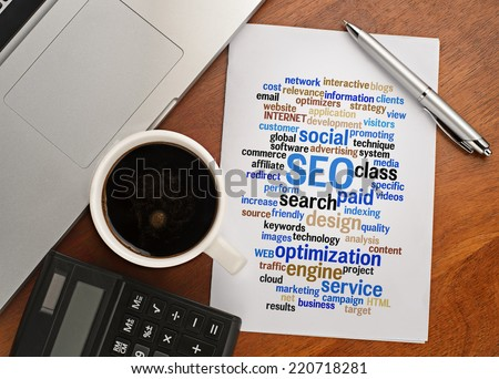 """SEO word cloud arrangement"" Notebook with text vision on table with coffee, calculator and notebook  - stock photo"