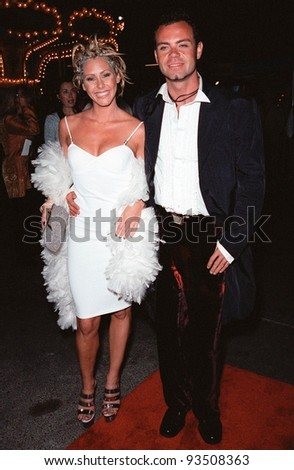 "24SEP99: Australian actress BRONWYN JONES & boyfriend TIM CHAPPEL at the opening of Cirque du Soleil's new show ""Dralion"" in Santa Monica, CA.  Paul Smith / Featureflash"