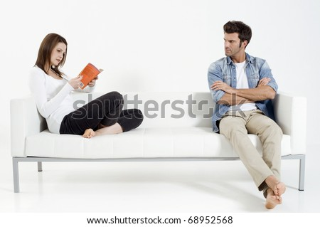 """separated couple on the sofa"