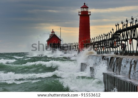 """September Gale""   Waves pound the Grand Haven Lighthouse in a Storm - Michigan USA - stock photo"