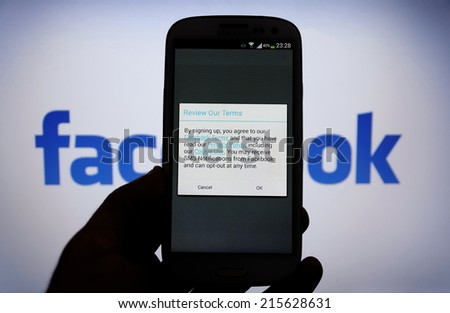 08 September 2014 Istanbul, Turkey: Facebook Term & Privacy page on mobile phone. More than 425 million active users access Facebook through mobile devices in 60 countries. - stock photo