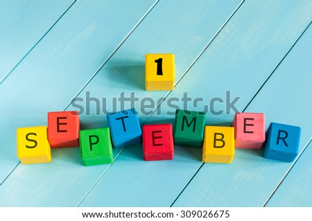 1 September sign on color wooden cubes with light blue wood background. Back to school time. - stock photo