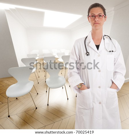 Serious female doctor in a conference room