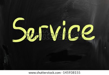 """service"" handwritten with white chalk on a blackboard - stock photo"