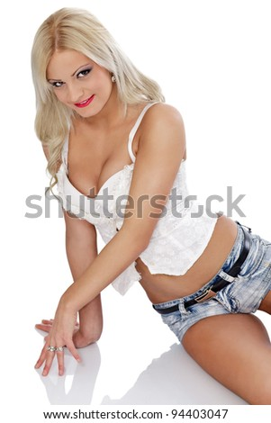 sexy blond  model wearing white corset and lying on floor - stock photo