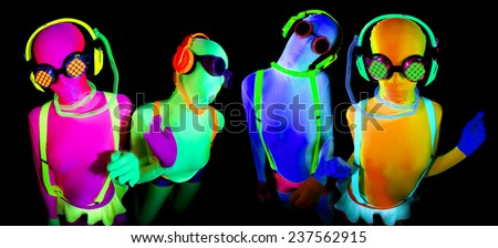 2 sexy female disco dancers poses in UV costume - stock photo