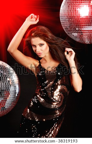 sexy girl dancing over mirror ball background - stock photo
