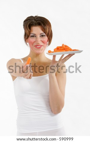 Sexy healthy woman with a glass with carrots