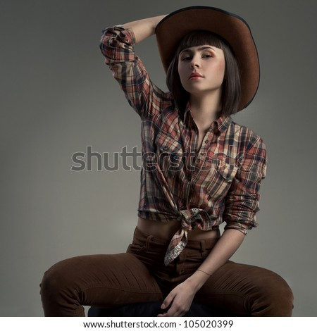 sexy woman in a hat  in an image of the American cowboy - stock photo