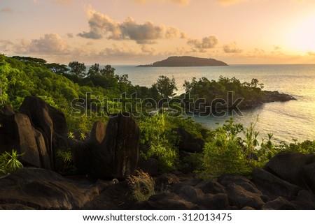 Seychelles at sunset - stock photo