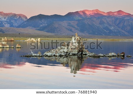 Shallow lake, a multitude of picturesque reefs Tufa. Magically beautiful sunrise. Sunrise at Mono Lake in the crater of an ancient extinct volcano. - stock photo