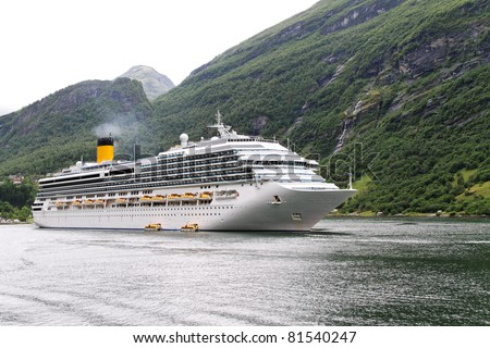 Ship in fjord. - stock photo