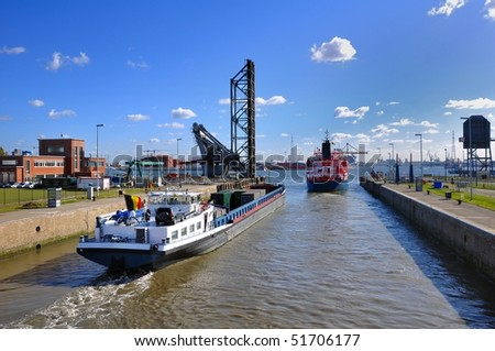 ship's passes through a sluice in  Holland - stock photo