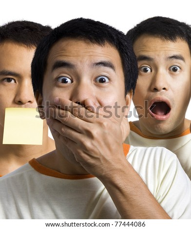 3 shocked, surprised and amazed men, one with his hand over his mouth - stock photo