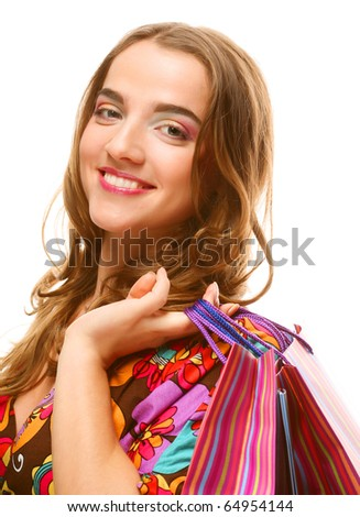 Shopping woman smiling. Isolated over white background