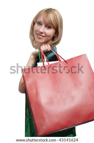 Shopping women smiling. Isolated over white background. - stock photo