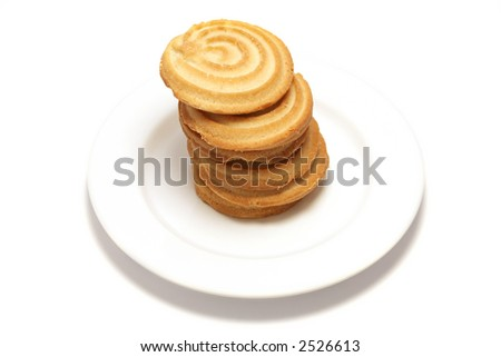 6 shortbread biscuits stacked on a white plate - stock photo