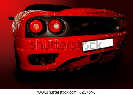 shot  of a red sports car (ferrari) - stock photo