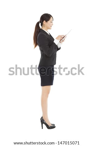 side view young  businesswoman holding tablet pc - stock photo