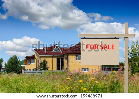 sign saying for sale on the background of the house - stock photo