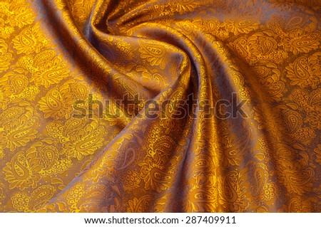 Silk. Lining brown. Closeup of lines in brown silk fabric. Brown background with shadows and smooth lines. brown background of shiny satin or silk folds - stock photo