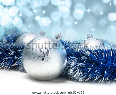 silver Christmas balls on a blue background - stock photo
