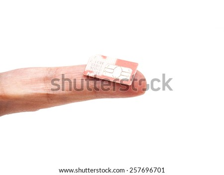 SIM card on finger isolated on white - stock photo
