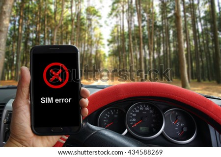 """""""SIM Error"""" showing on the smartphone inside of a pickup truck - stock photo"""