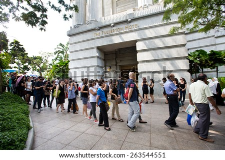 14 SINGAPORE - MARCH 24:Queue outside Fullerton Hotel  to pay last respect to the late Mr Lee Kuan Yew, ex prime minister of Singapore,lying in state at the parliament house. Mar 24, 2015, Singapore. - stock photo