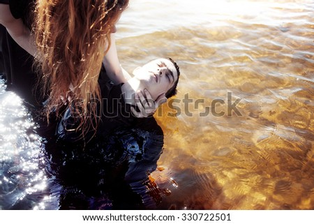 Sinking in the problems. Young man experiencing  pain and disappointment - stock photo