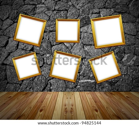 six empty frames in a room against a white brick wall - stock photo