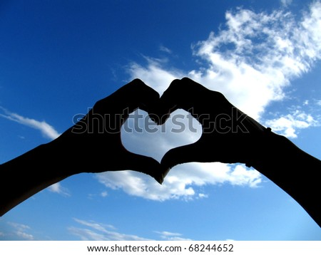 Sky with heart on clouds - stock photo