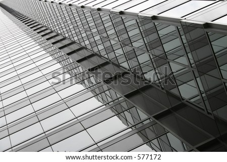 Skyscraper shot at an angle, windows giving a diminishing optical rhythm. Unretouched. - stock photo