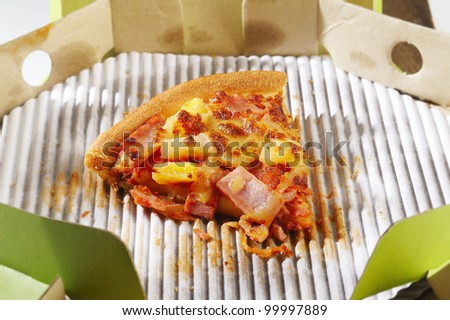 slice of pizza  in the box - stock photo