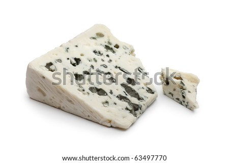 Slice of Roquefort cheese on white background