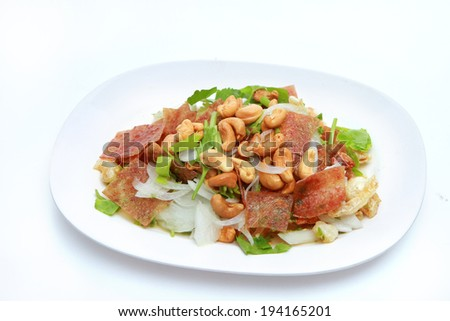 ... sheets of dried and crispy pork mixed with spicy salad - stock photo
