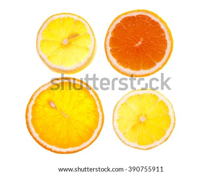 4 slices of lemon, orange and grapefruit on a white background. Isolate. Good for icons. - stock photo