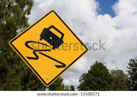 """Slippery When Wet"" road sign - stock photo"