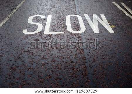 """SLOW"" sign on the road, London, UK - stock photo"