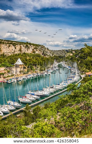 Small fjords between Marseille and Cassis in Calanque National Park. White sailboats moored in rows near the shore - stock photo
