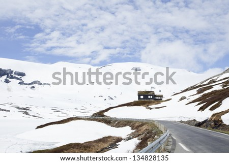 Small house in the mountains in Norway - stock photo