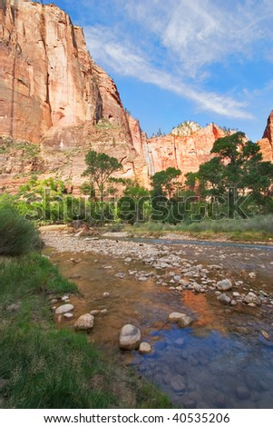 Small shallow river at the bottom of a canyon in National park Yosemite in the USA - stock photo